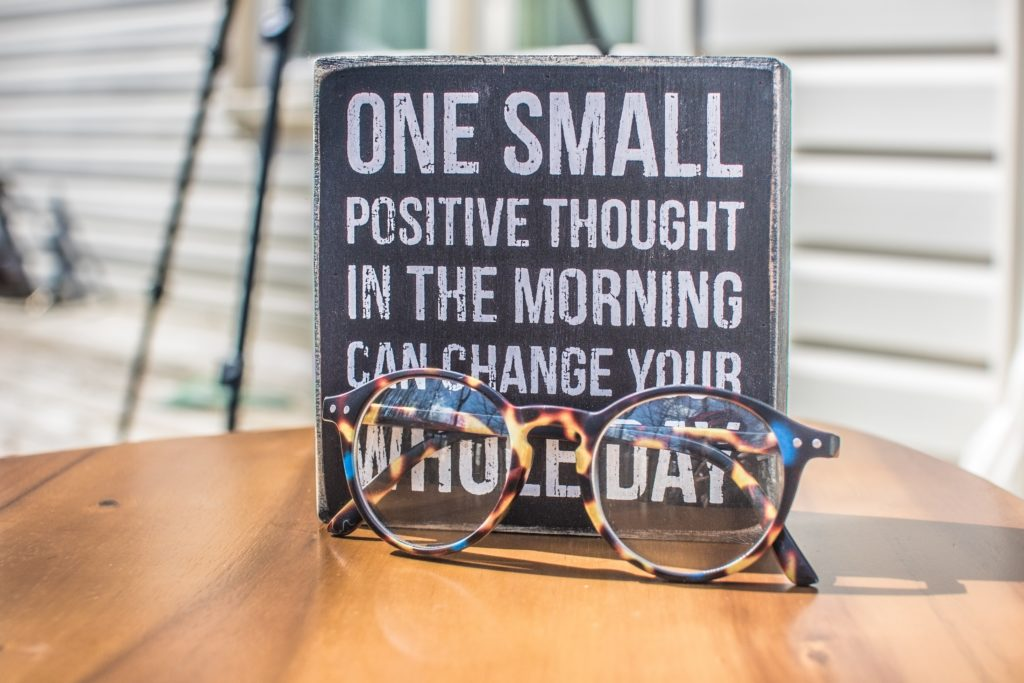 Positive Quote on a book - 'One Small positive thought in the morning can change your whole day'
